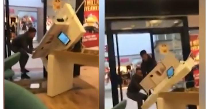 英國搶匪嫌一隻一隻手機拿走太麻煩,試圖將整個手機展示台搬走